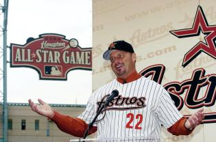 Roger Clemens signs with the Houston Astros