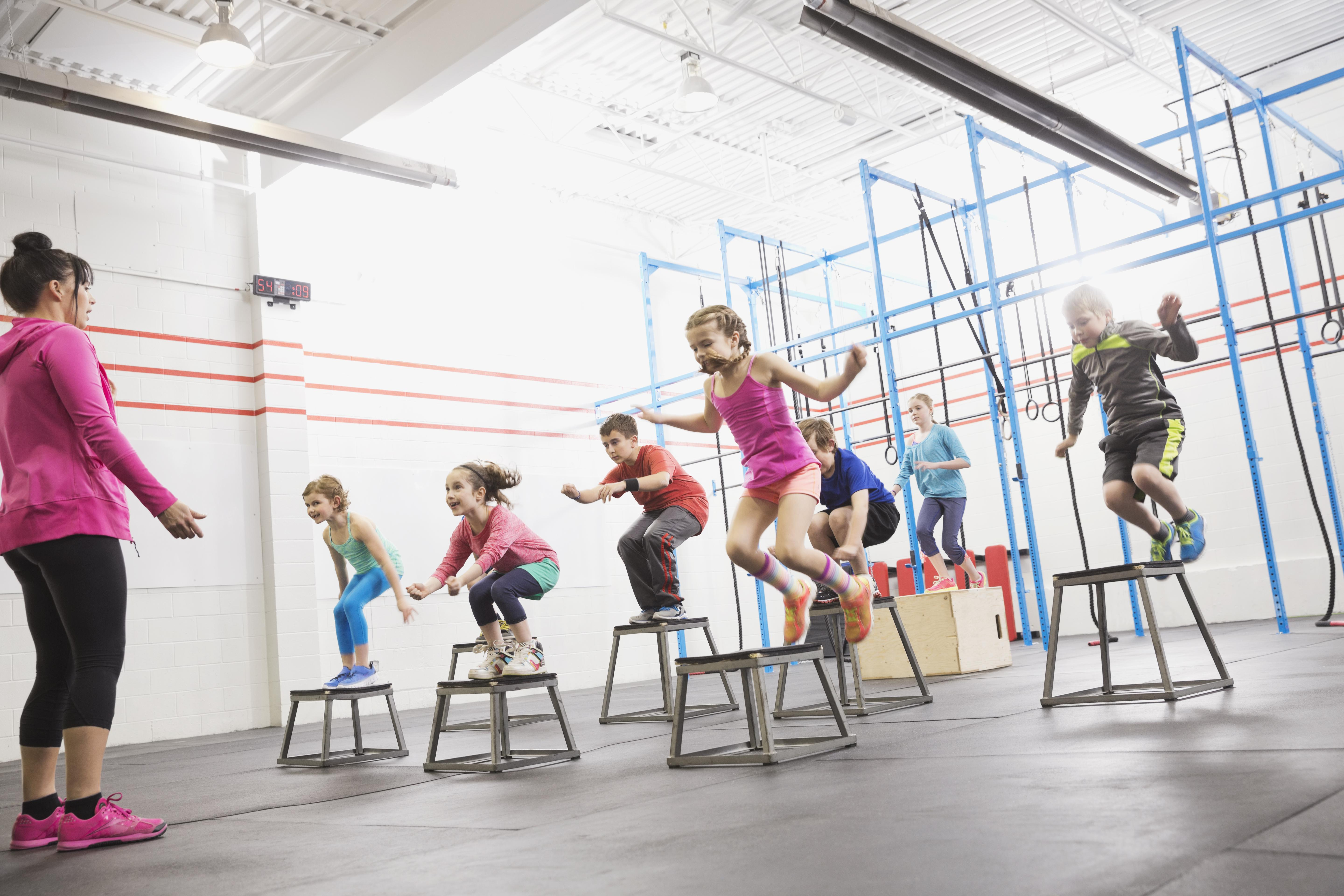 Children doing box jumps at gym