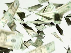 CU, Twenty dollar bills falling against white background