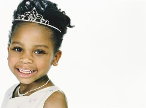 Studio Portrait of a Young Girl Wearing a Tiara and Dressed as a Princess