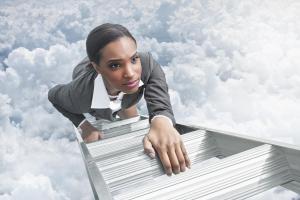 African American businesswoman climbing ladder