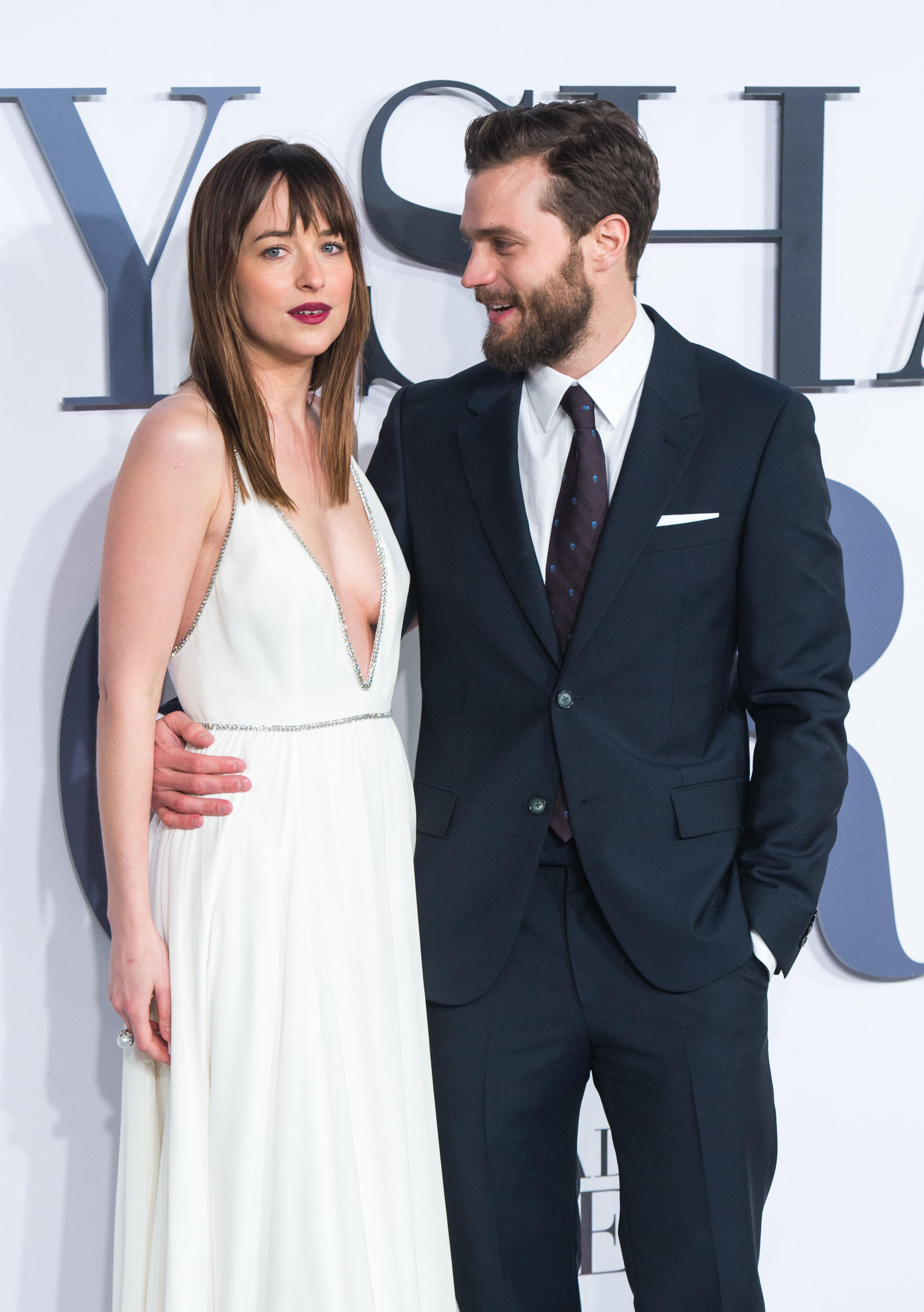 Jamie Dornan and Dakota Johnson attend the UK Premiere of 'Fifty Shades Of Grey'