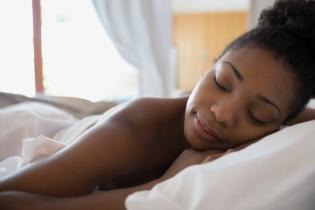 Serene woman sleeping in bed