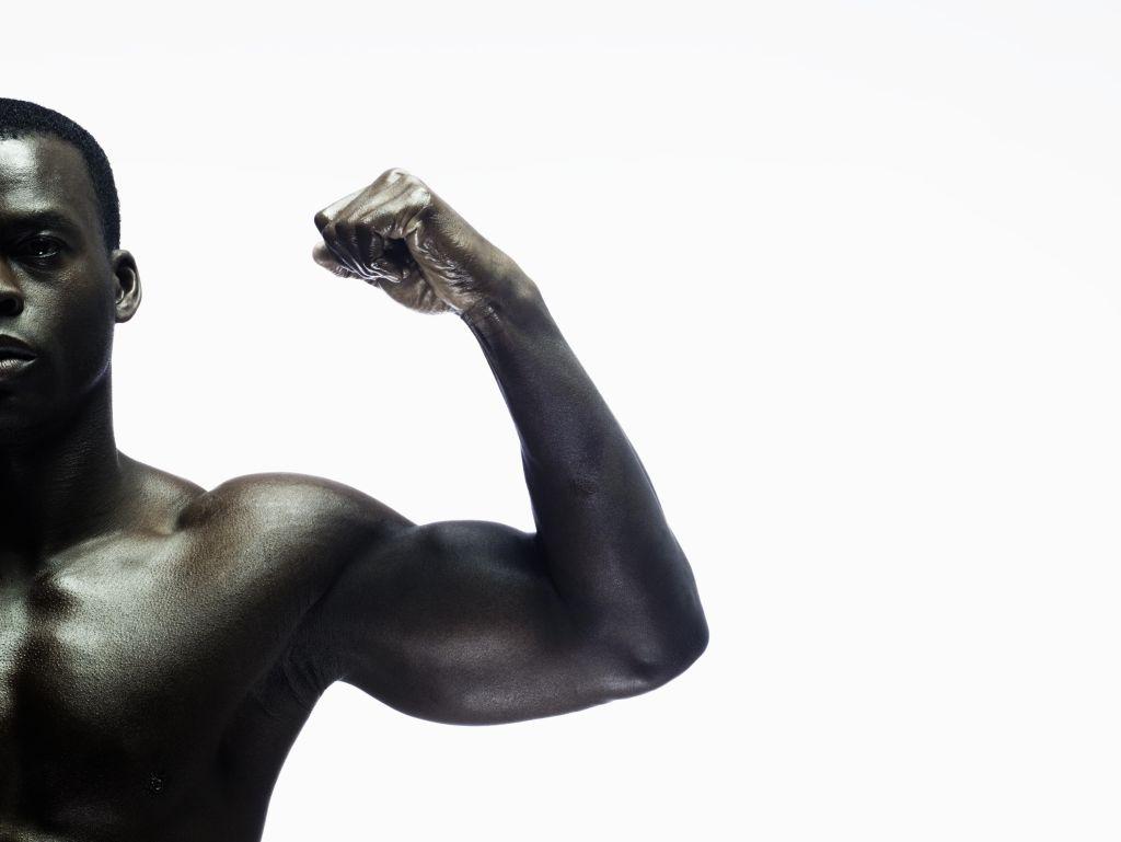 Man showing biceps, portrait, close-up
