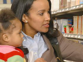 CU, Woman shopping with daughter (12-17 months), Richmond, Virginia, USA