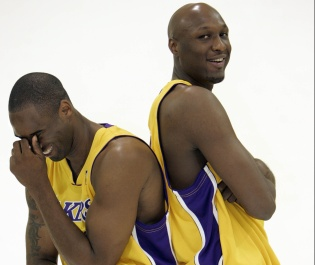 Kobe Bryant, left, and Lamar Odom of the Los Angeles Lakers share a laugh together in between being