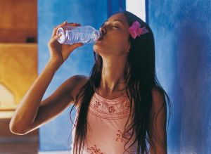 Thirsty Woman Drinking From a Bottle of Water
