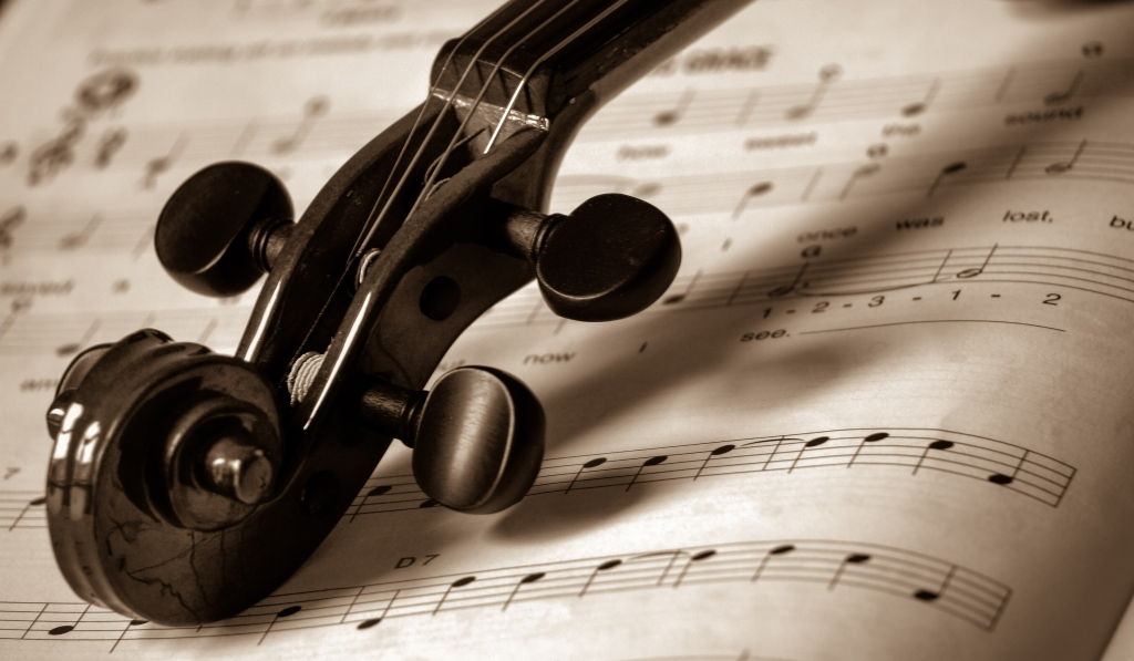 Close-Up Of Violin And Sheet Music