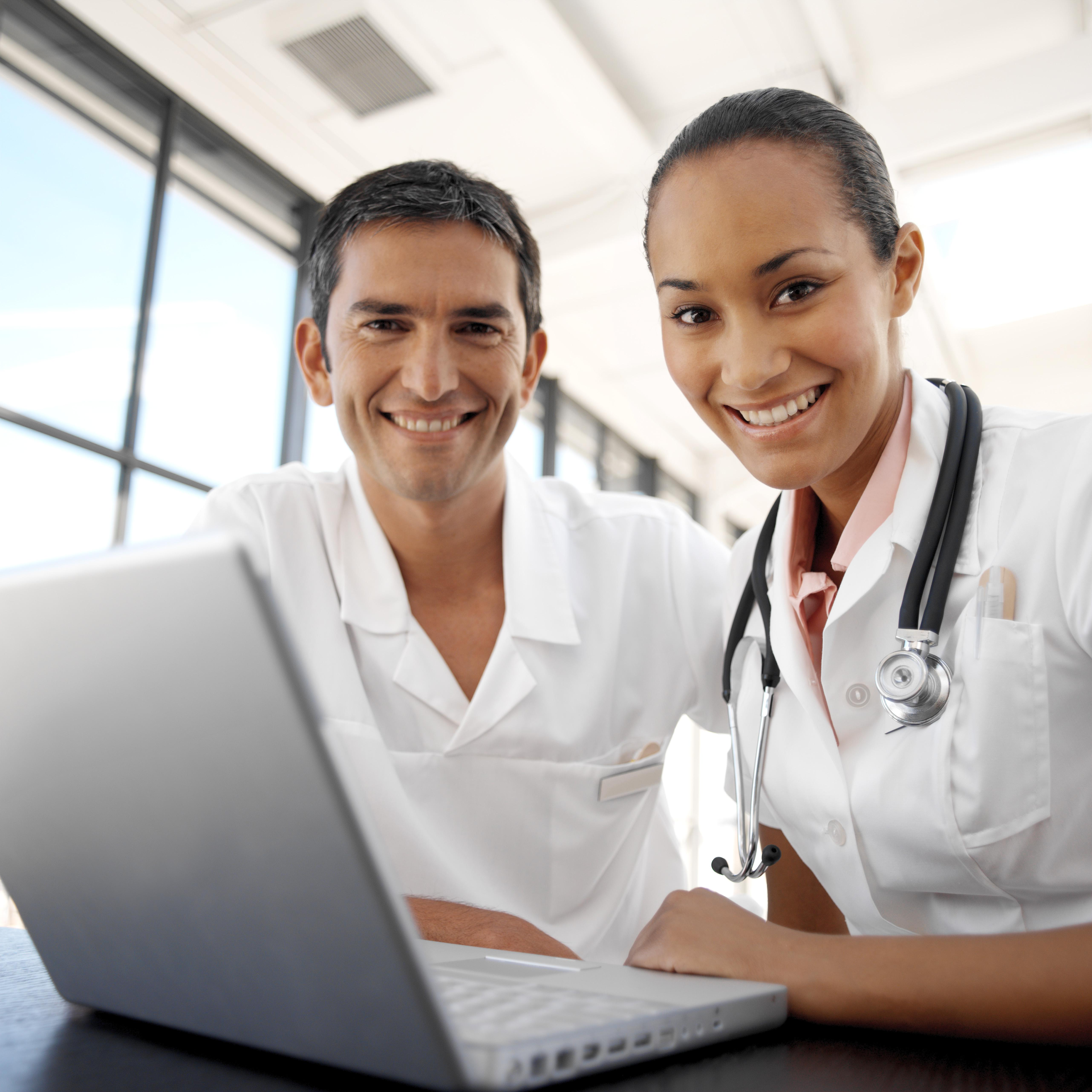 portrait of young medical personnel in front of a laptop