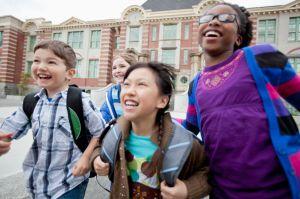 elementary students running outside school