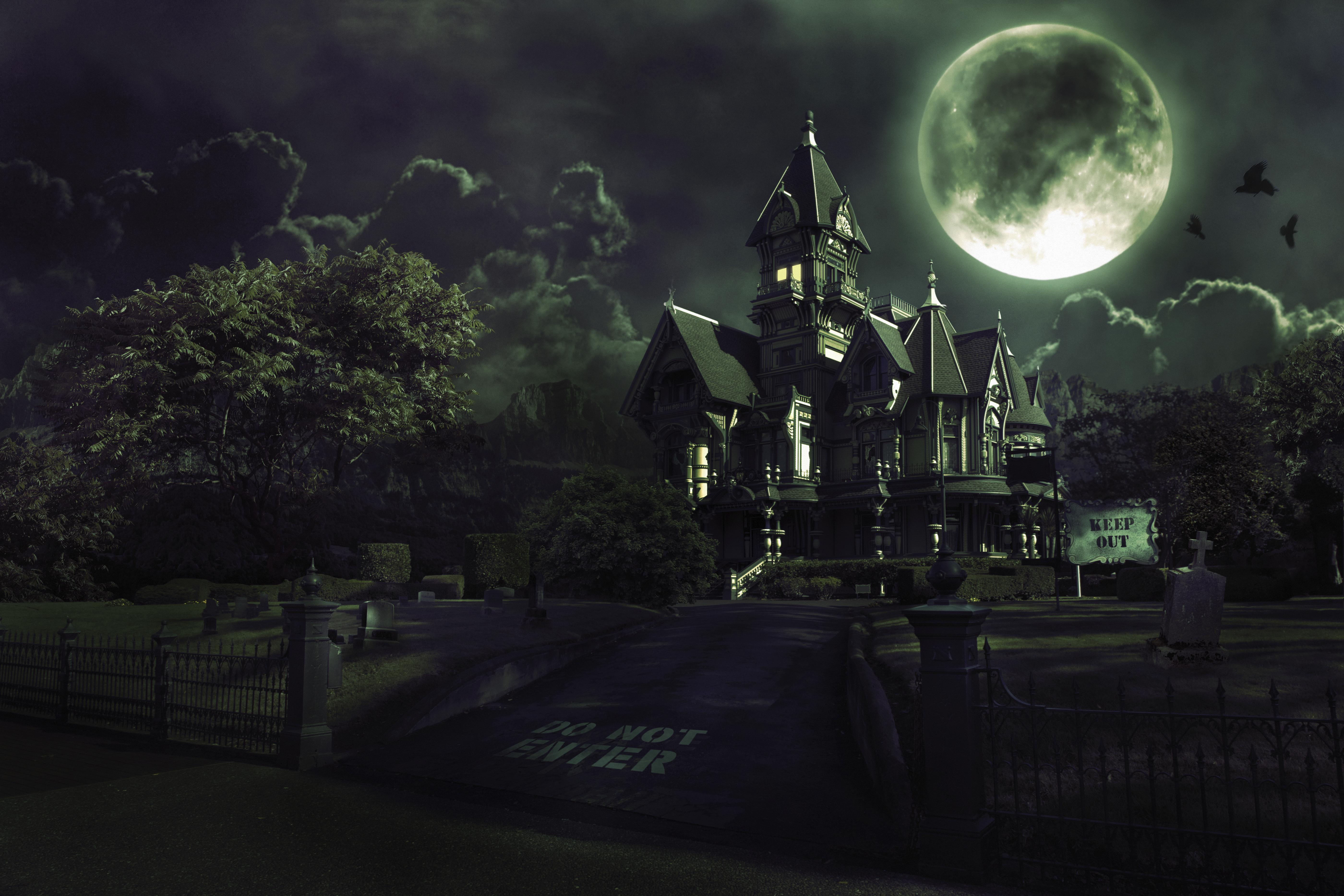 Full Moon Over Haunted House with Graveyard for Halloween