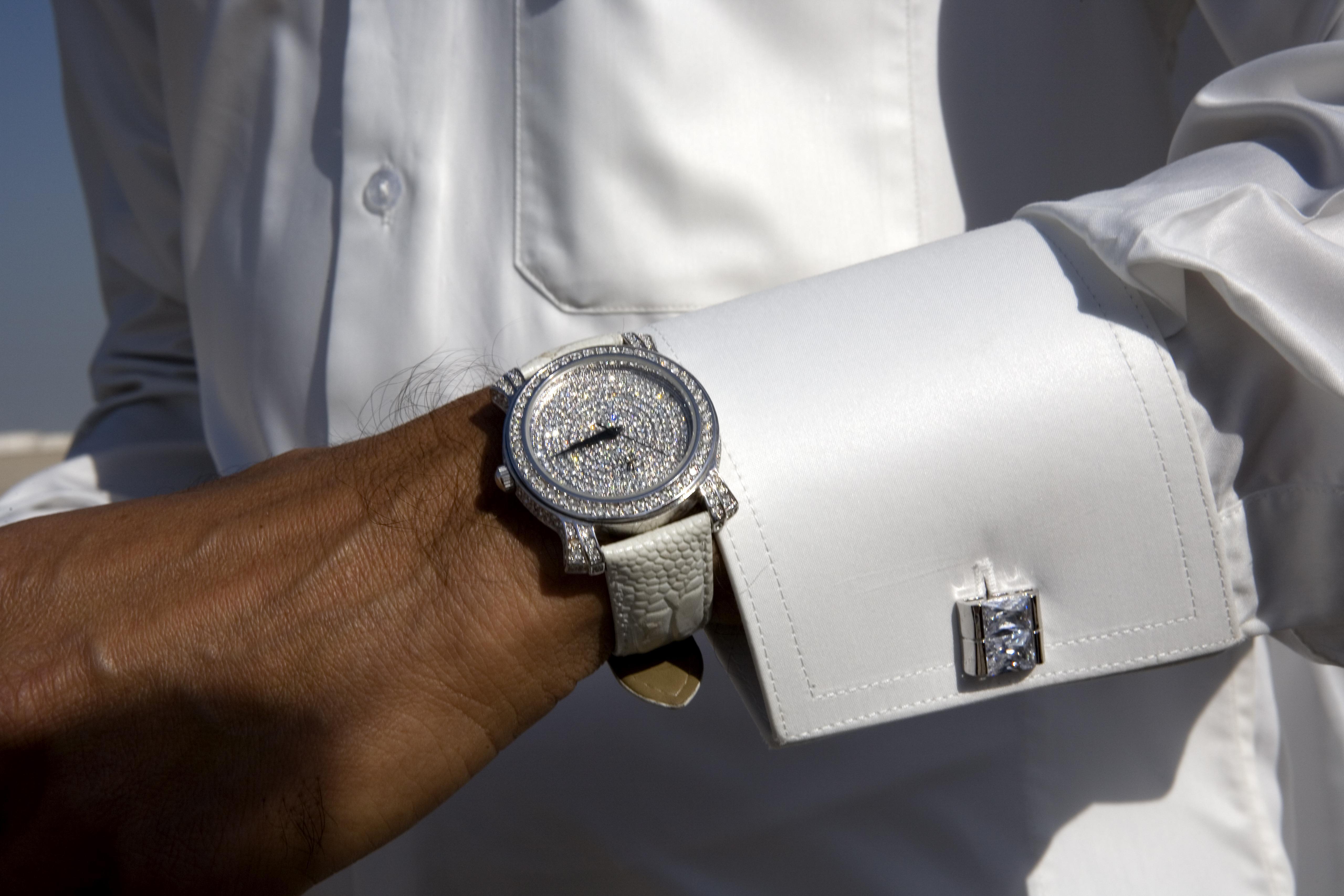A Qatari wears a diamond-studded watch.