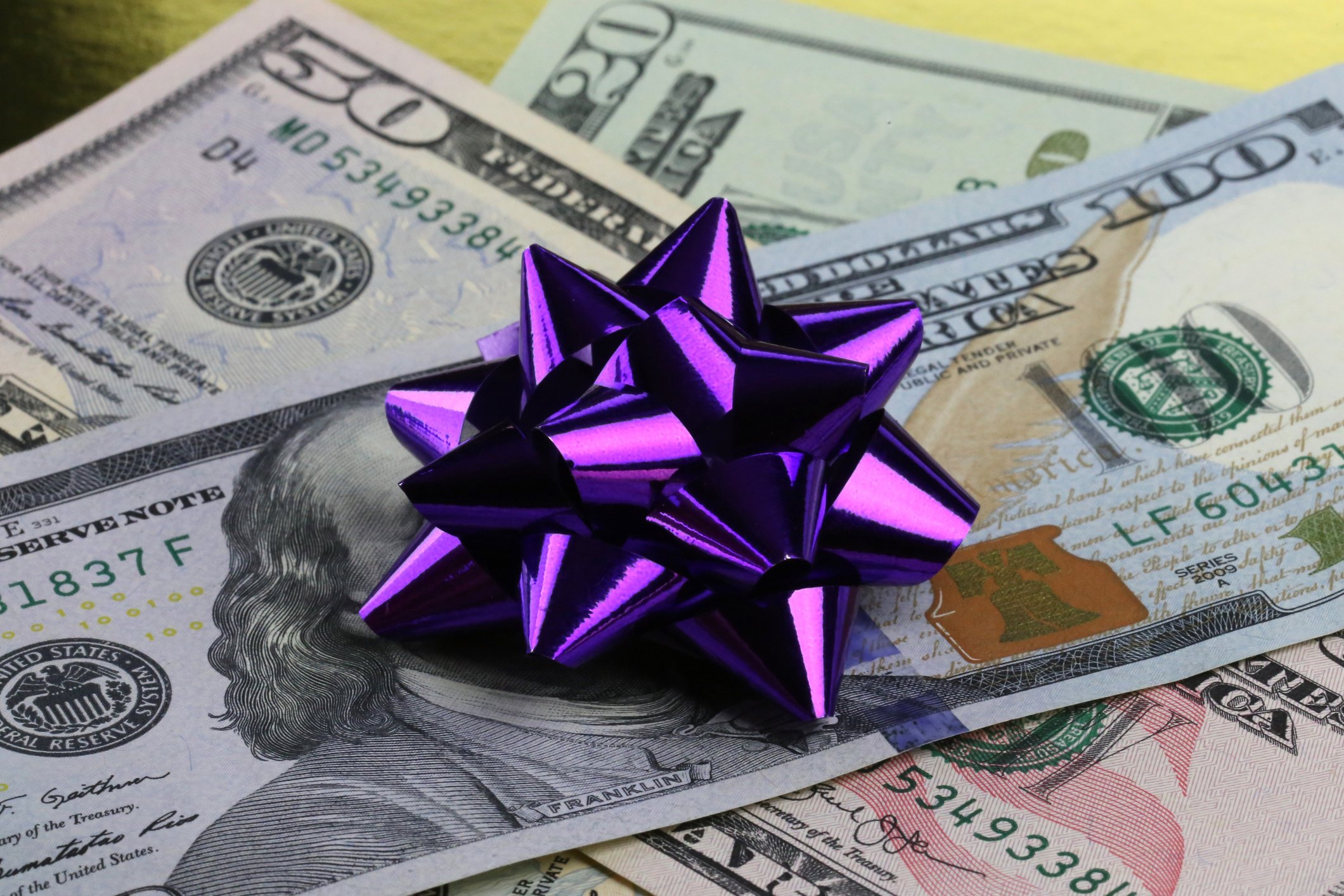 US cash with a gift bow