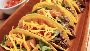 Six Beef Tacos with Lettuce, Tomato and Cheese