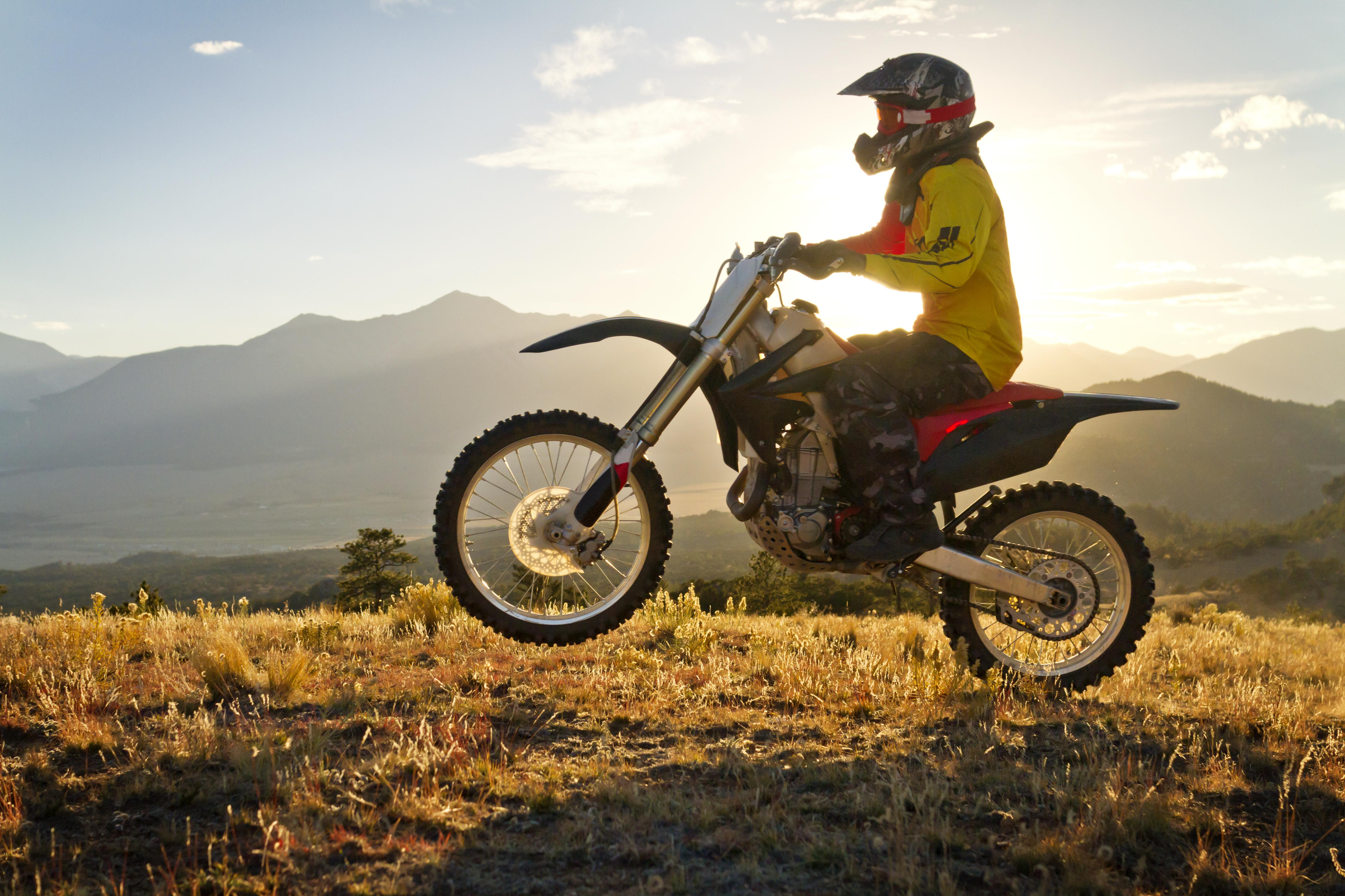 Man Riding Dirt Bike On Mountain