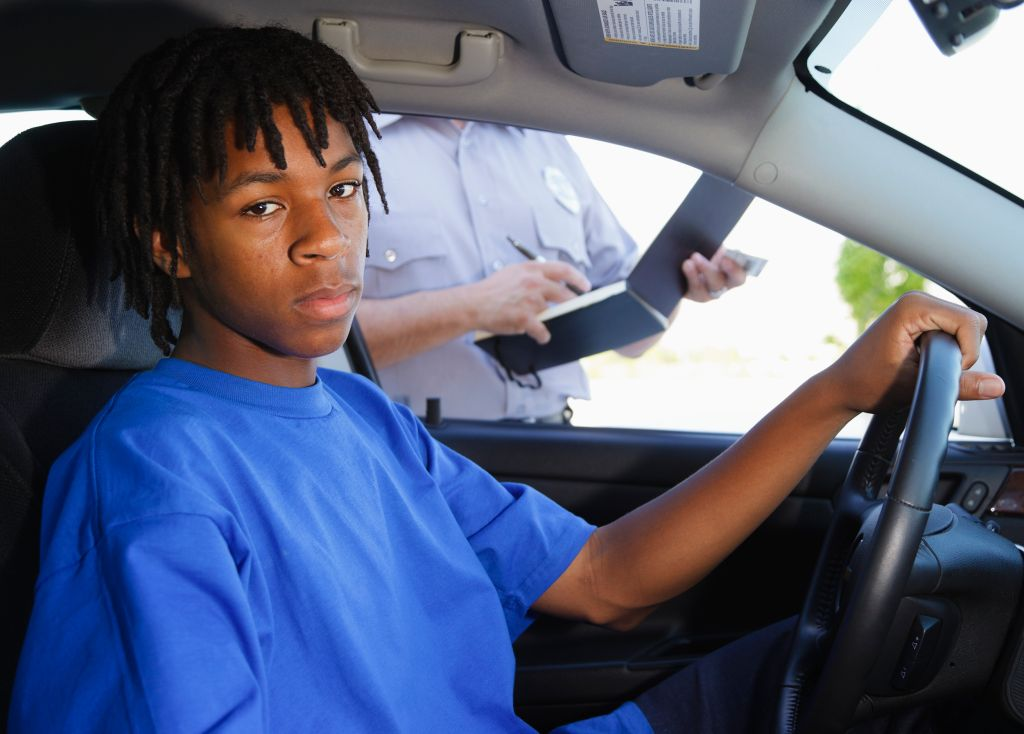 Teenage Boy Receiving a Ticket