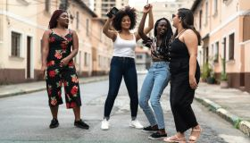 Group of diverse friends dancing at street