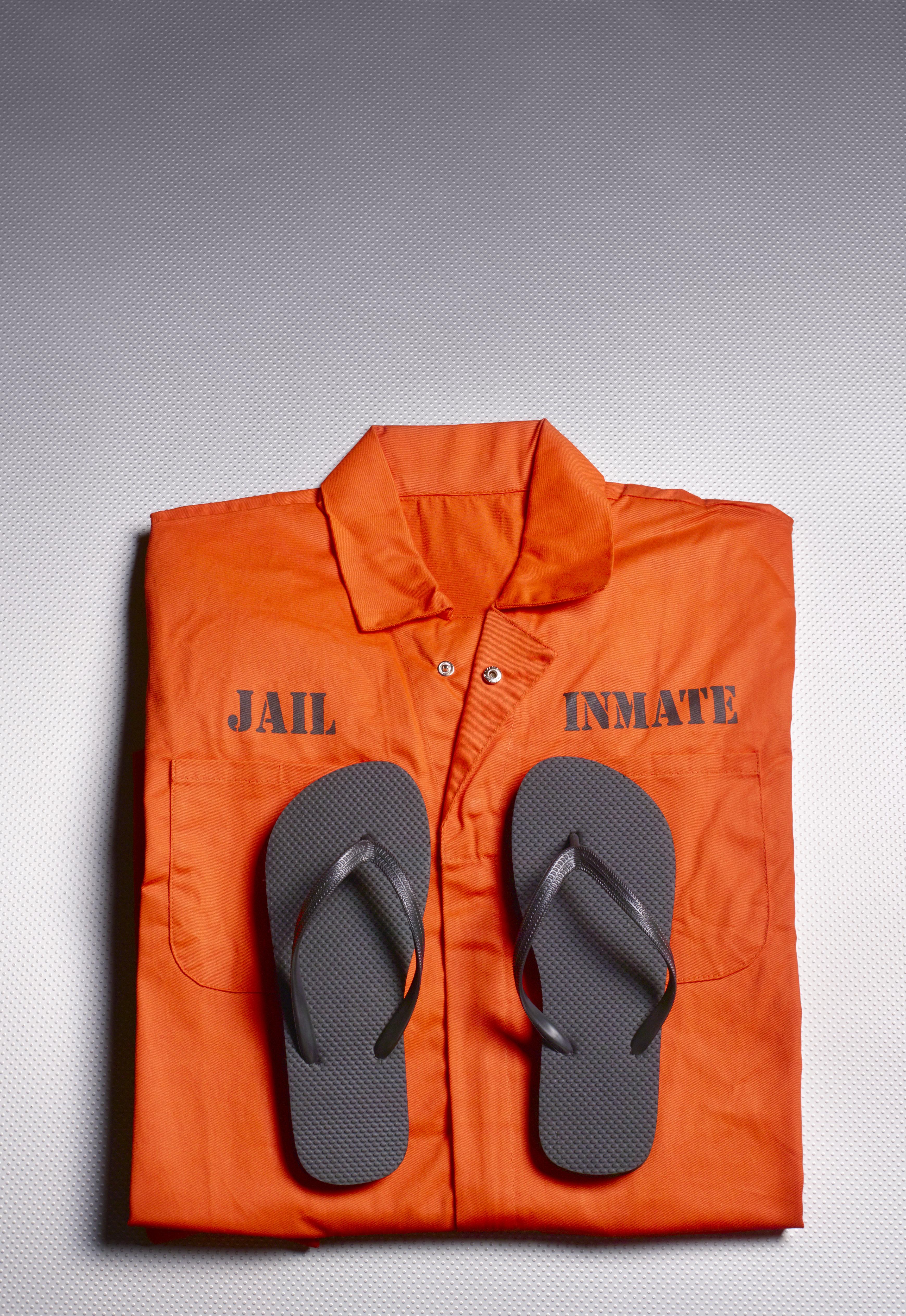 Orange jump suit in prison cell