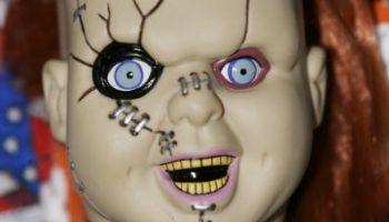 A fan displays a Chucky doll
