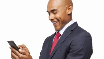 Male Professional Using Cell Phone - Isolated