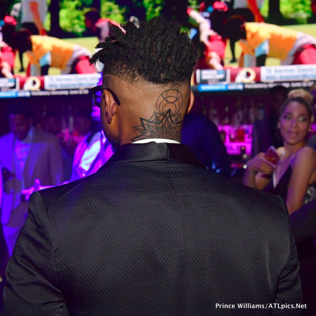 Usher shows new neck tattoo at Party For Usher producer Keith Thomas