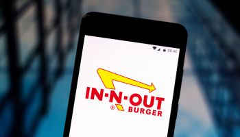 In this photo illustration an In-N-Out Burger logo seen...