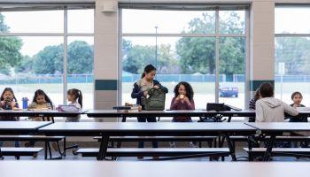 Group of schoolchildren eating lunch