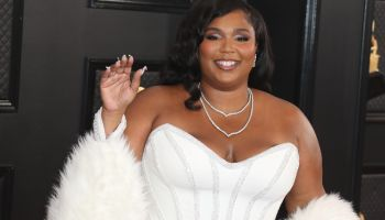 Singer Lizzo wearing an Atelier Versace dress, Rene Caovilla shoes and Lorraine Schwartz jewelry arrives at the 62nd Annual GRAMMY Awards held at Staples Center on January 26, 2020 in Los Angeles, California, United States.