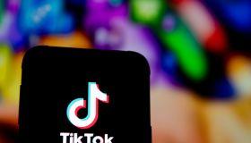 In this photo illustration a Tik Tok logo seen displayed on...