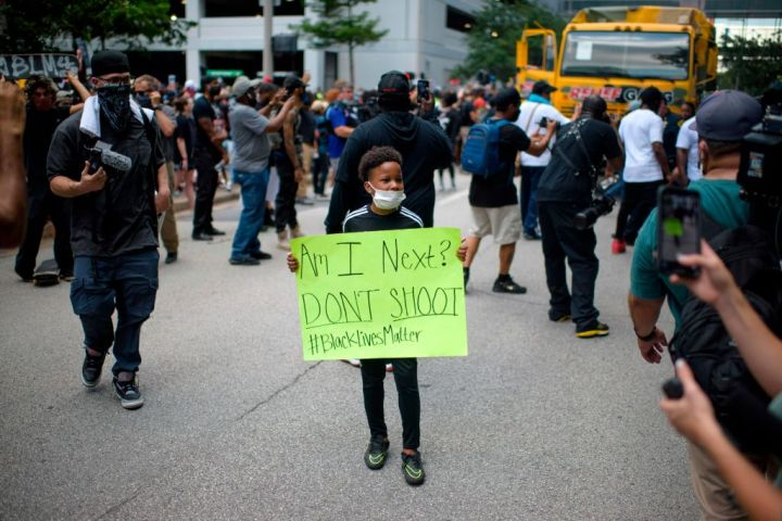 "Child With Sign ""Am I Next?"" - Houston Protests"